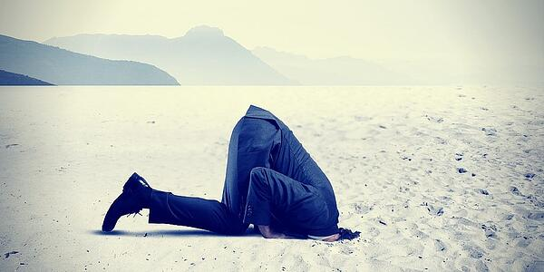 admit-mistakes-man-with-head-in-sand