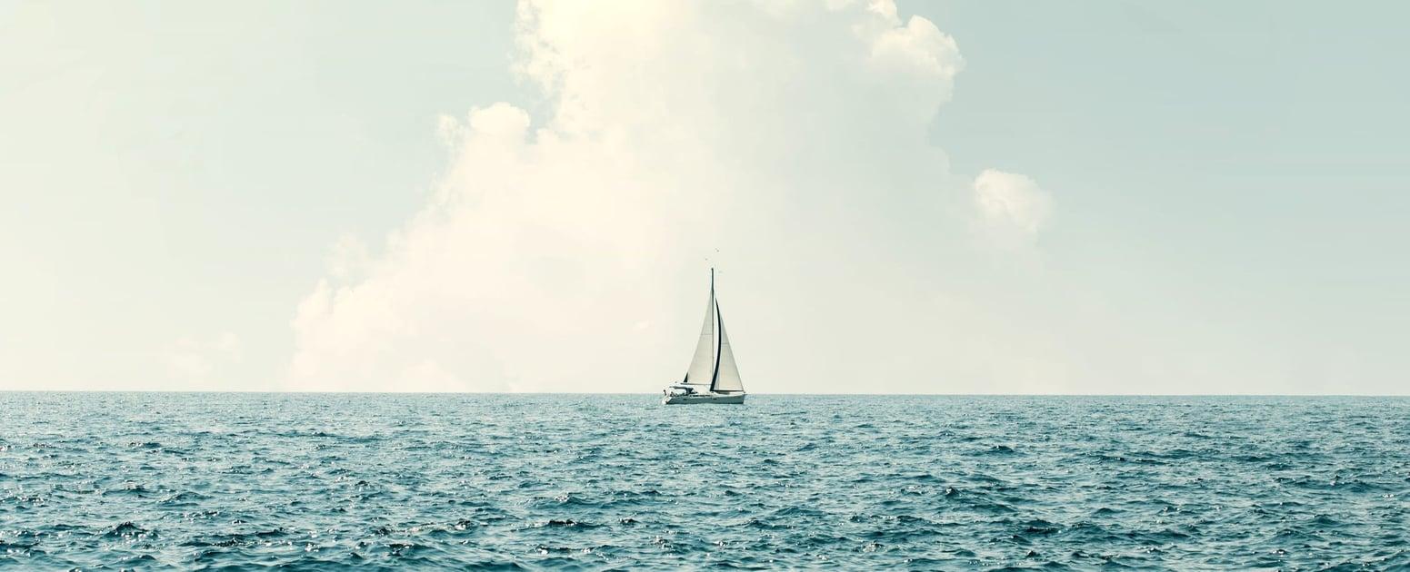 sailboat-calm-sea-minimalism-crop