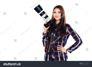 stock-photo-pretty-young-woman-taking-pictures-on-the-camera-isolated-over-white-117234940
